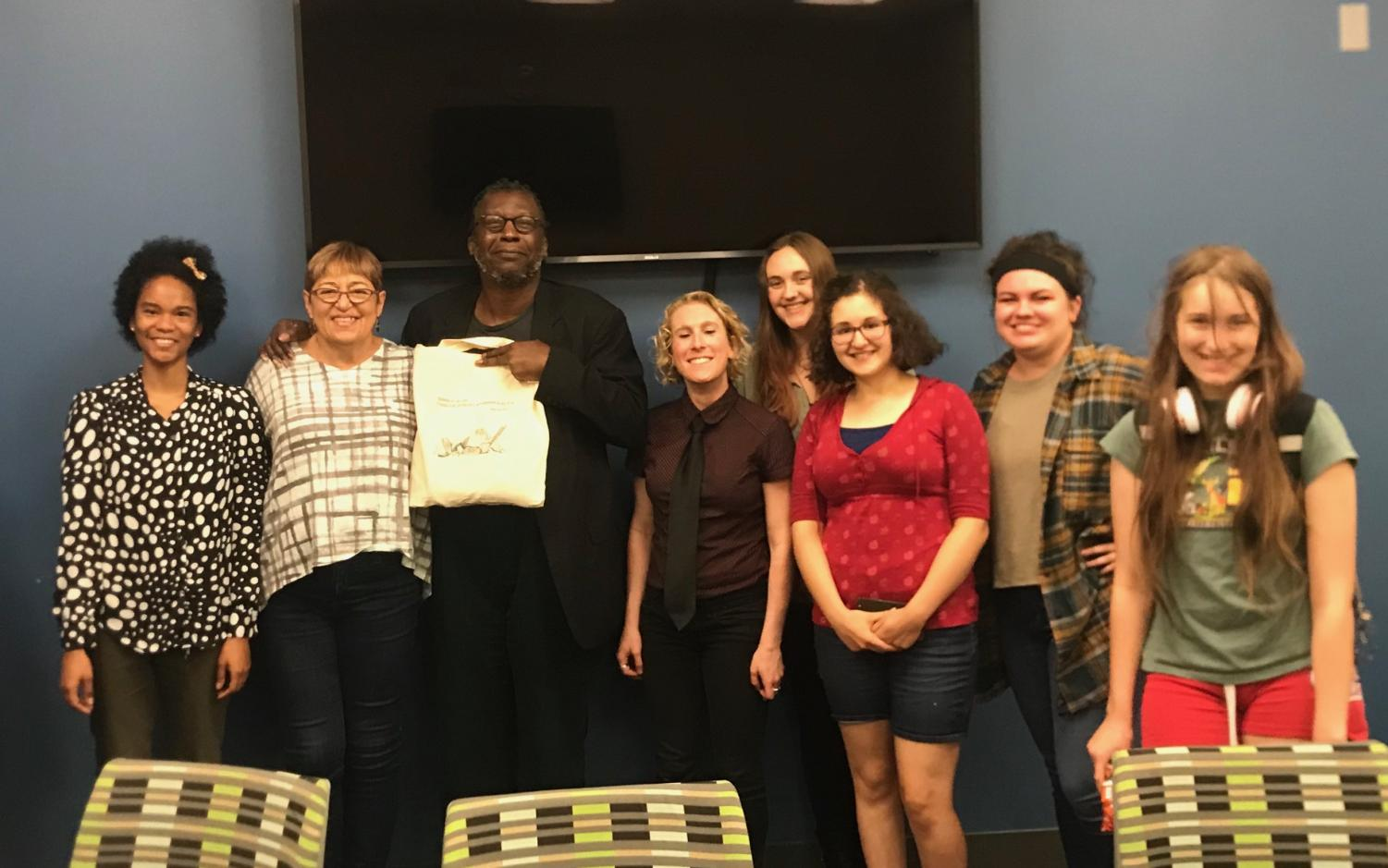 The people who came to the workshop, with  Toi Derricotte one person from the left, and Cornelius Eady to the right of her.