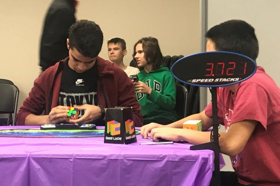 Anuj Jani 22 solving a Rubik cube at the North Liberty 2019 competition.
