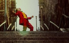 Joker (Joaquin Phoenix) dances down a staircase in an iconic scene from the film