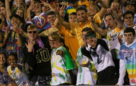 James Pinter '20 and members of the student section pose for a pictures as they cheer on the Trojans against Bettendorf on Sept. 6.
