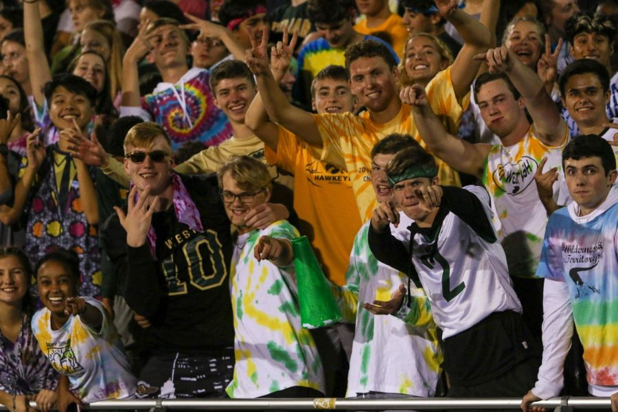 James+Pinter+%2720+and+members+of+the+student+section+pose+for+a+pictures+as+they+cheer+on+the+Trojans+against+Bettendorf+on+Sept.+6.