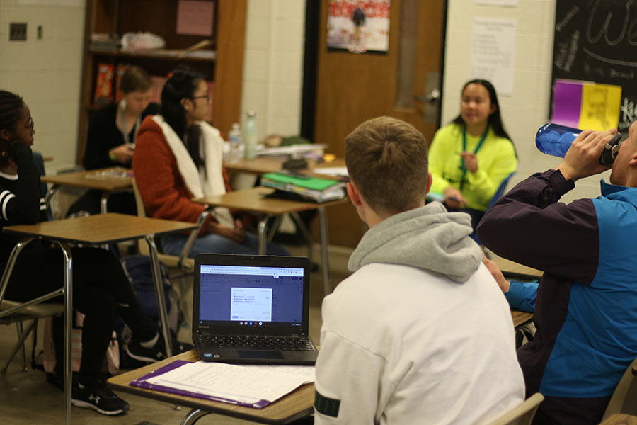 Food for All club leader Tate Crane '20 and club members plan the future of West High's welcome center on Oct. 31.