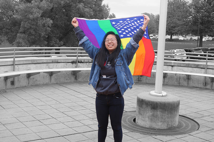 Michelle Kim '20 outside of West High showing her pride in her identity as a member of the LGBTQ+ community