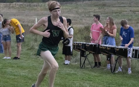 Trojans battle Prairie Hawks, humidity in home cross country meet