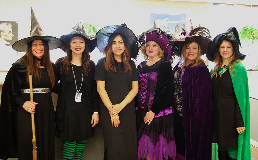 The secretaries of West High pose as witches this Halloween.