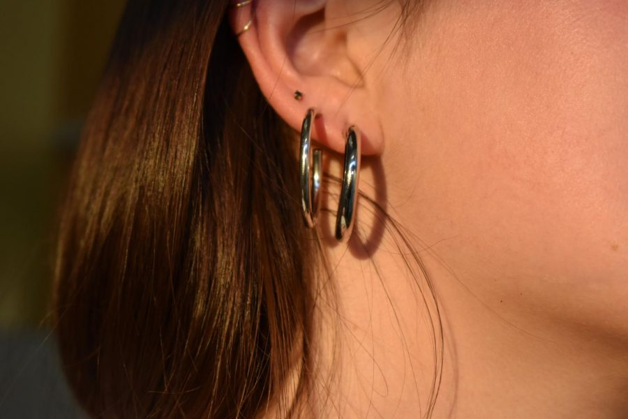 Frances Blount '21, known for her unique fashion and style, shows off her many earrings.