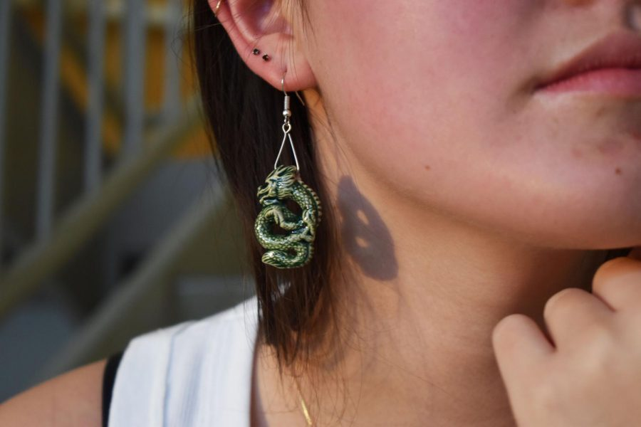 Blount wears a pair of her favorite earrings with emerald clay dragons.