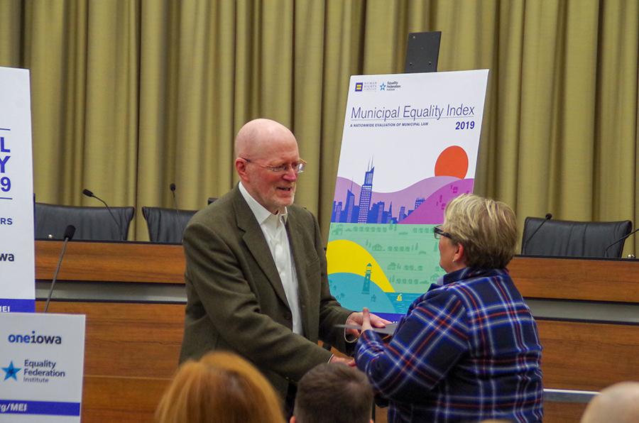 Mayor James Throgmorton shakes hands with JoDee Winterhof as he hands her a proclamation concerning Transgender Remembrance Day.