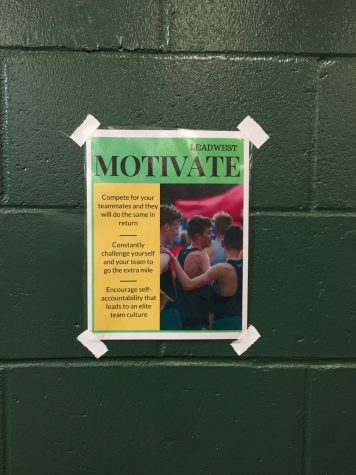 One of five Lead West posters is displayed above the free weights in the West High weight room. Each poster focuses on one of Lead West