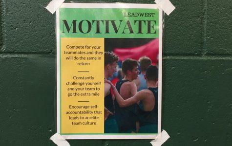 One of five Lead West posters is displayed above the free weights in the West High weight room. Each poster focuses on one of Lead West's five core values.