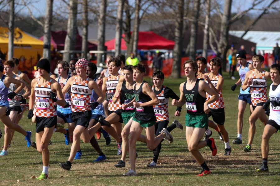 Nicolo Schianchi 22, Alex McKane 22, and Caden Noeller 22 sprint off the start line during the state cross country meet on Nov. 2 in Fort Dodge.