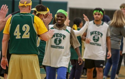 Byamungu Omari '20 high fives the faculty after the third annual Best Buddies and PALS basketball game against faculty on Nov. 7.