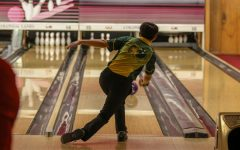David Jang '22 bowls a spare on Nov. 26 at Colonial Lanes against City High.