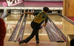 David Jang 22 bowls a spare on Nov. 26 at Colonial Lanes against City High.