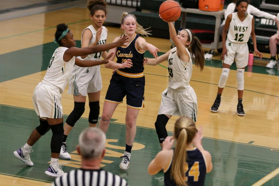 Grace+Schneider+%2720+fights+for+a+loose+ball+in+the+first+half+of+the+team%27s+game+against+Cascade+on+Nov.+22.+Schneider+is+a+senior+member+of+Lead+West.