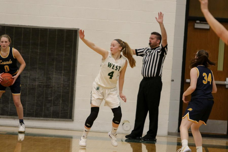 Shooting+guard+Cora+Saunders+%2720+denies+a+pass+while+playing+defense+against+Cascade+on+Nov.+22.+Saunders+finished+with+four+assists+against+the+Cougars.