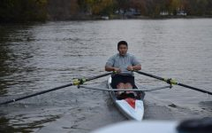Jim Li '21 rows hard on a cold day in a race between him, the team boats and the doubles.