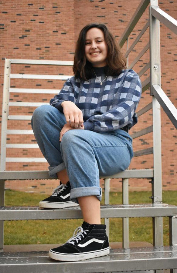 Natalie Dunlap '20 poses on the steps of a temp near the ninth grade center.