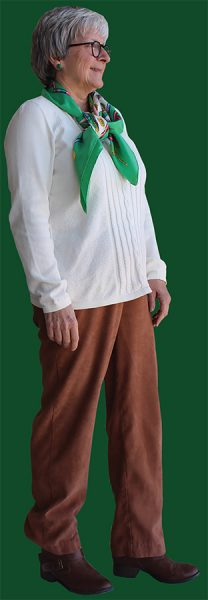 Walker dons a more simple look with a classic white sweater and brown pants.