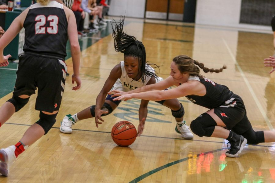 Matayia Tellis '21 fights for a loose ball against Western Dubuque.