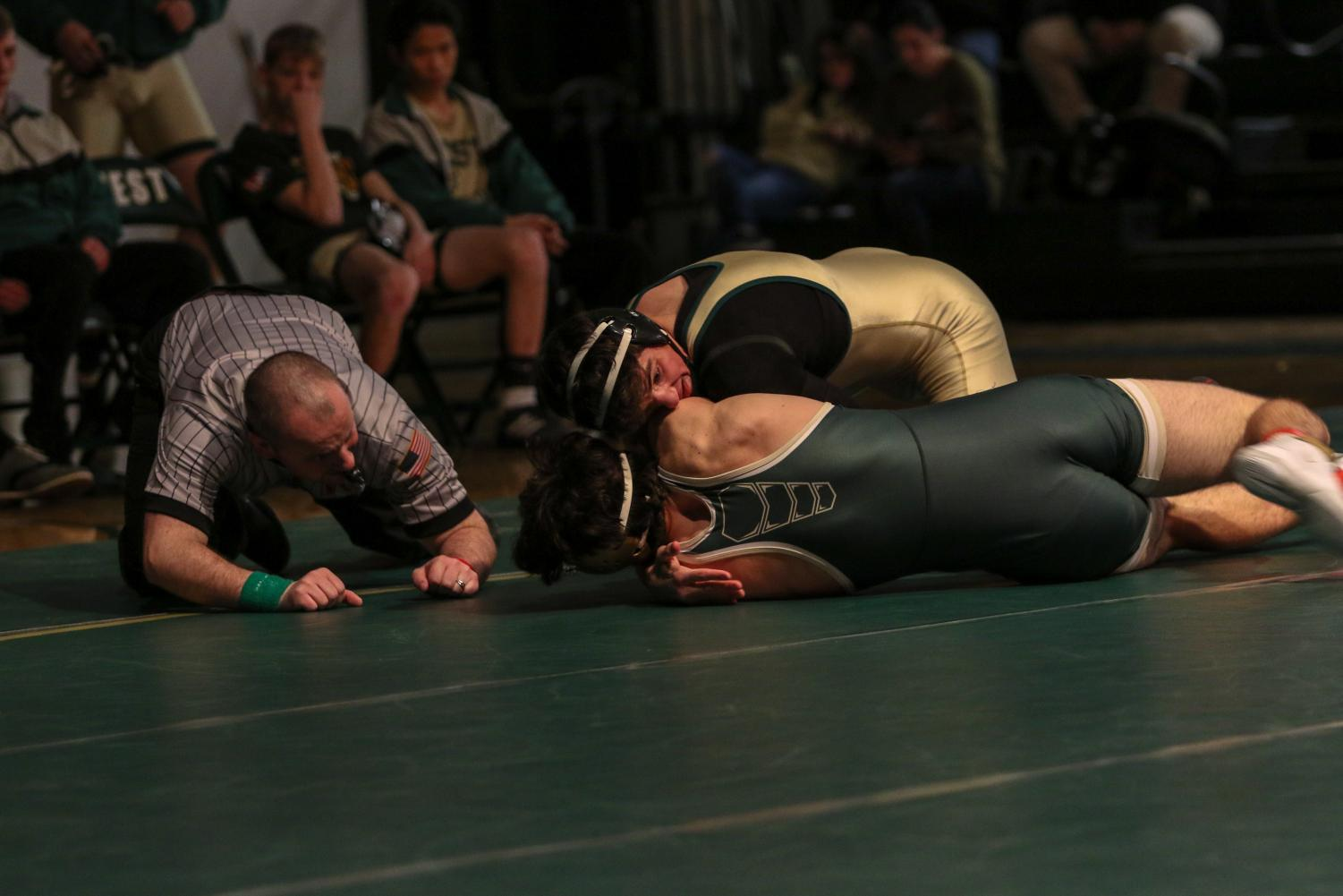 Ashton Barker '21 tries to turn his opponent during his match at 182 pounds. Barker pinned Hempstead's Andrew Hefel '20 in 1:08.