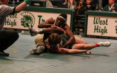 Boys wrestling team falls in home opener to Dubuque Hempstead