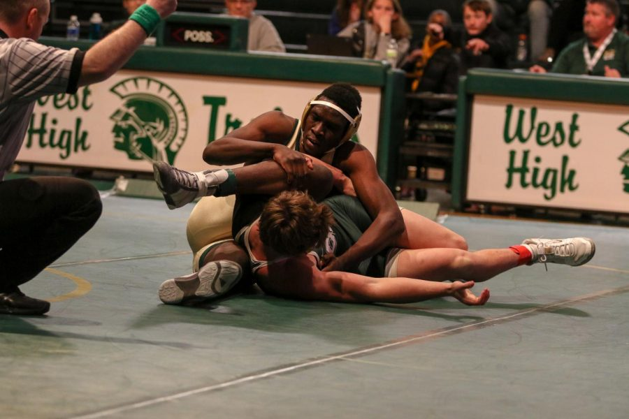 Newcomer Anu Dokun '20 fights for position during his 195 pound match against Adam Ward '21. Dokun fought back from a 7-3 deficit to force an extra period, but ultimately fell 11-9. Dokun transferred to West from Memphis for the beginning of his senior year.