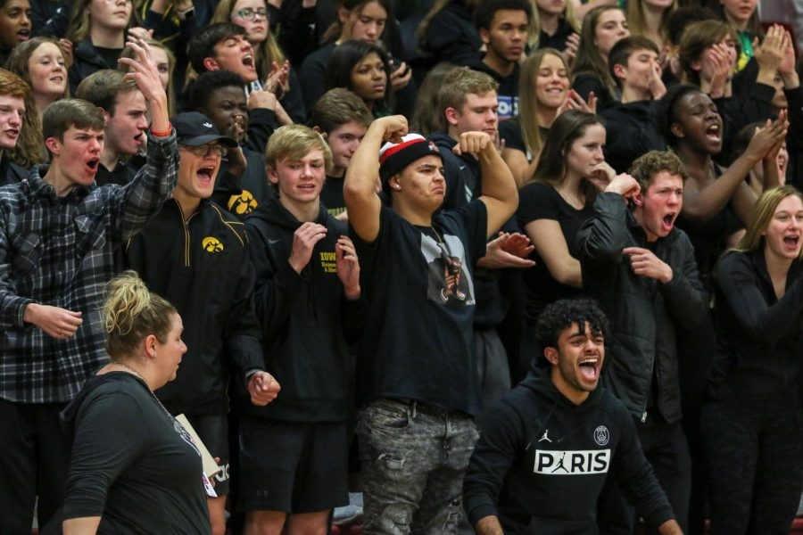 Makhi Halvorsen '20 and student section members celebrate senior Even Brauns' and-one against City on Dec. 14.