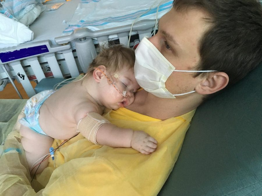 John Boylan holding Emilia Emmie Boylan during the recovery for Emmies cyst surgery.