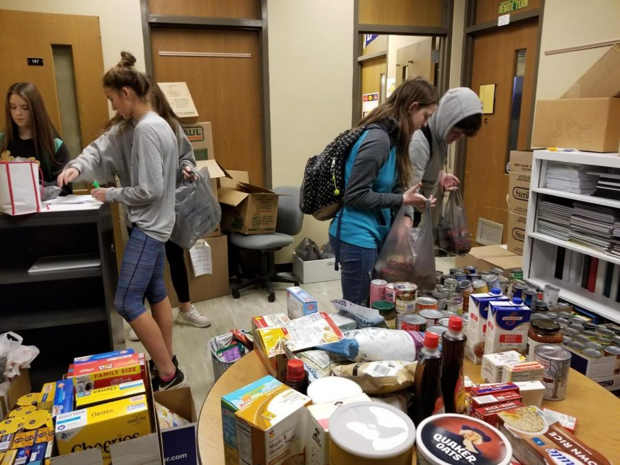 Students+help+organize+resources+at+West+High+Supply.+