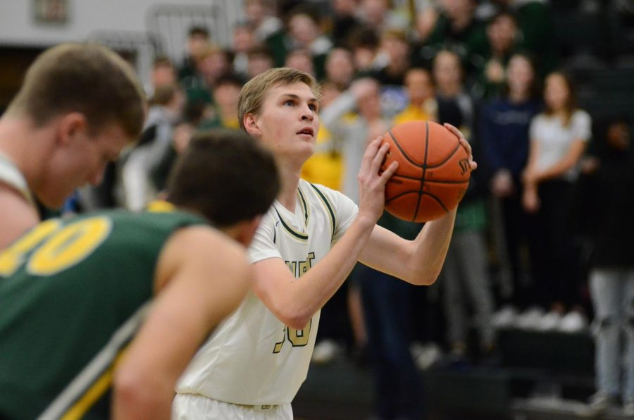 Andrew Tauchen '21 shoots his first of two free-throws after being fouled Jan. 7.