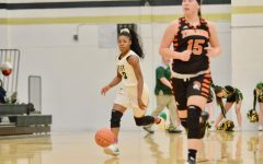 Matayia Tellis '21 dribbles the ball down the court on Jan. 15.