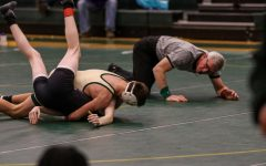 Boys wrestling team beats Muscatine, Liberty in triangular meet