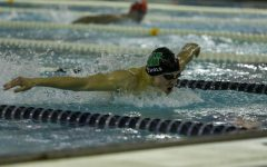 Boys swimming team finishes undefeated dual season with win over City High