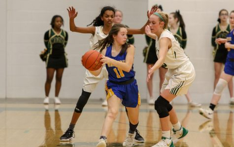 Defense puts Women of Troy past Dubuque Wahlert