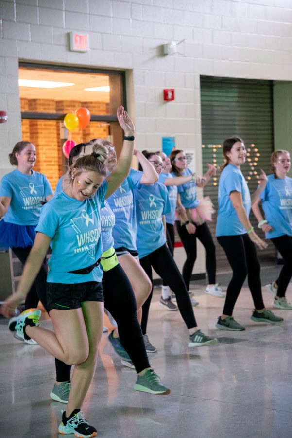 Austyn Goodale '20 and other dancers follow secretary Heather Yoder in a workout-dance routine to the song