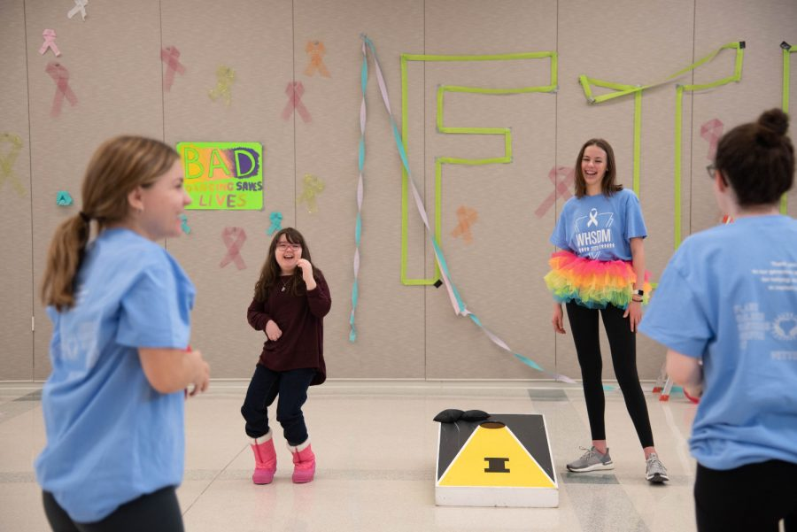 Lucy Roth, Misha Canin 22, Lauren Schafer 20 and Lila Terry 20 play bean-bag-toss in between dancing.