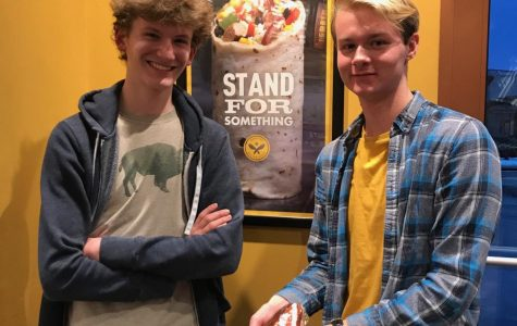 Julian Wemmie '20 and Riley Bridges '20 pose with a burrito in Pancheros.