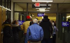 Voters in district IC08 wait in line to register for the caucus.