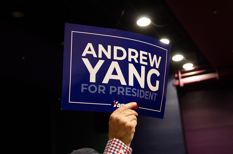 A voter in district IC09 holds a sign advertising their support for Andrew Yang. Overall, Yang placed 6th in the popular vote and received no pledged delegates.