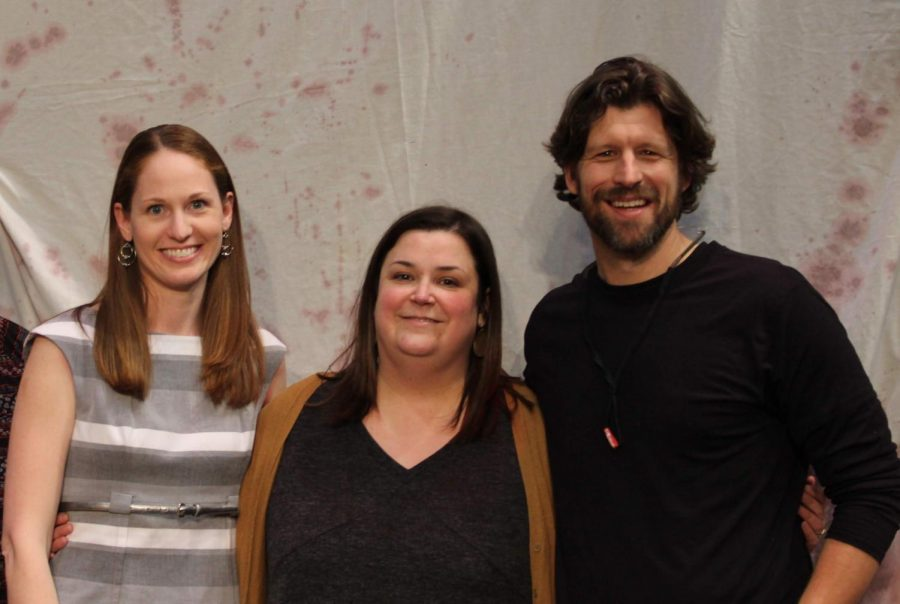 Katy Nahra, Ann Rocarek and Christian Aanestad pose in front of a sheet stained with fake blood after the 2019 spring musical,