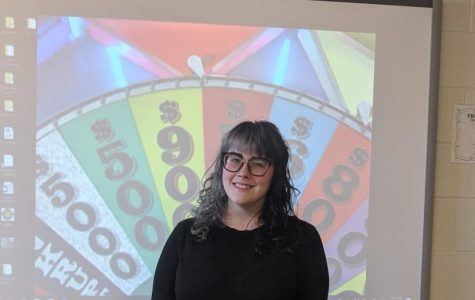 Paraeducator Farren Kerr poses for Wheel of Fortune submission photo.