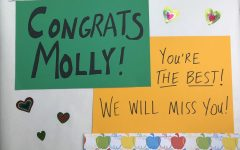 Staff members made signs as part of the parade celebrating Molly Abraham's retirement.
