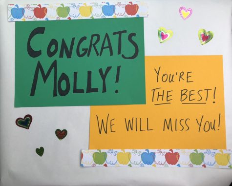 Staff members made signs as part of the parade celebrating Molly Abraham