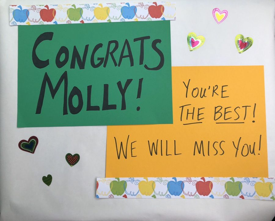Staff+members+made+signs+as+part+of+the+parade+celebrating+Molly+Abraham%27s+retirement.+