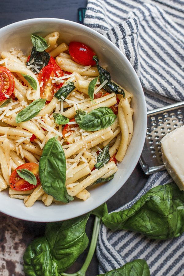 Top with Parmesan and fresh basil to complete this dish