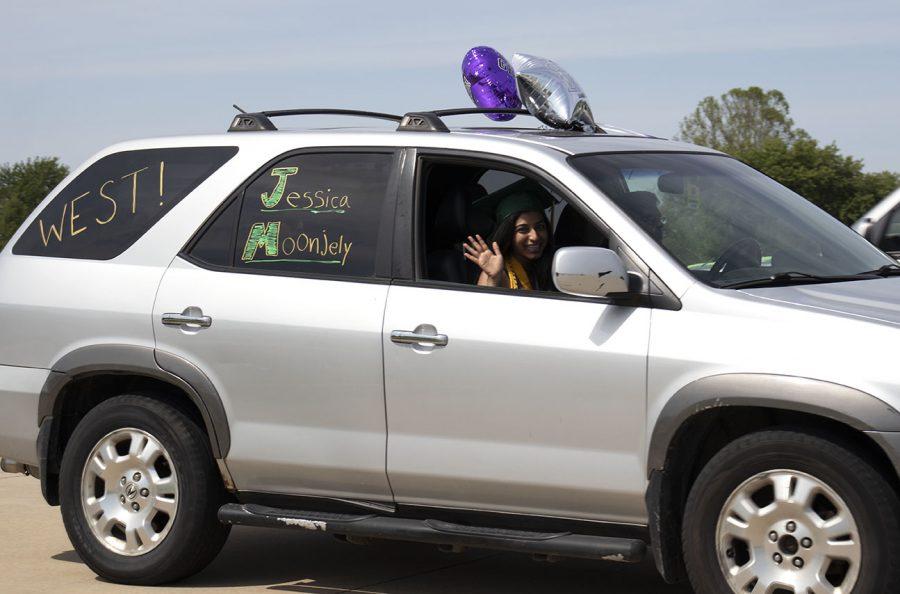 WSS staffer Jessica Moonjey waves goodbye to high school.