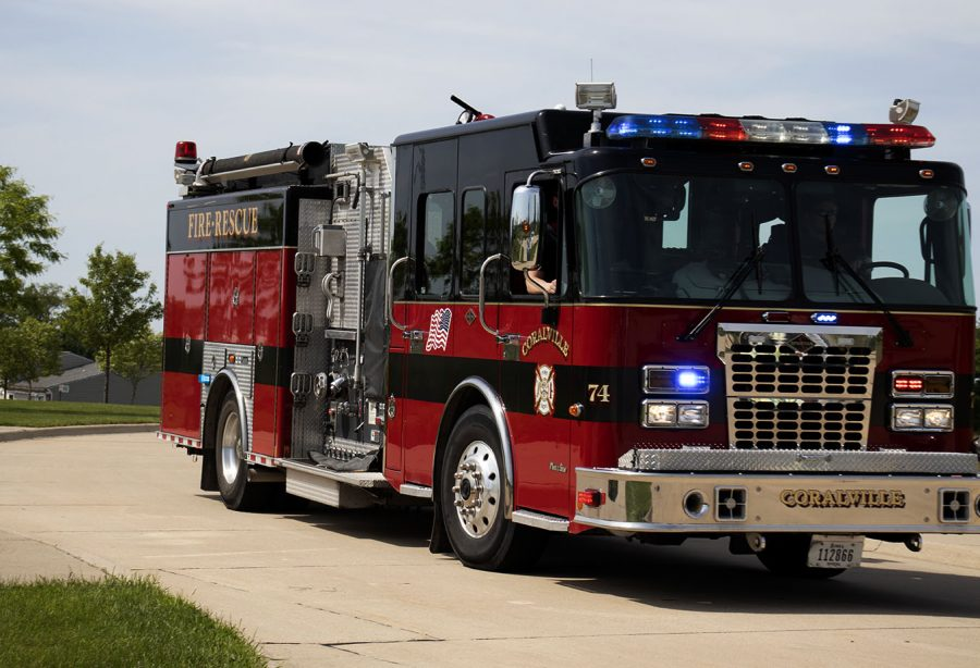 The Coralville Fire Department leads the West senior car parade out of the Coralville Youth Sports Complex on May 31.