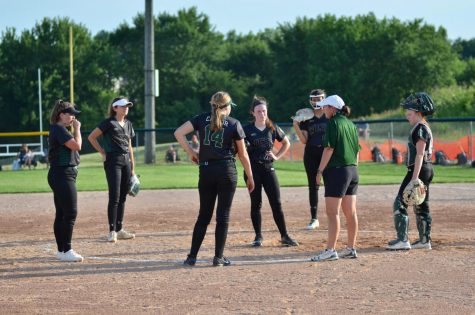 The team gathers in the infield during a timeout in the first game of the doubleheader on June 18.