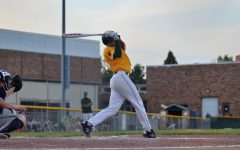 Marcus Morgan 21 swings towards a ball while playing against Xavier.